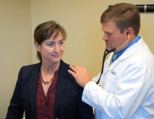 photo of doctor with a patient | Alpharetta Internal Medicine